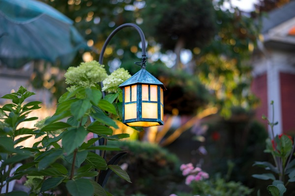 Decorative garden lantern with amber glow