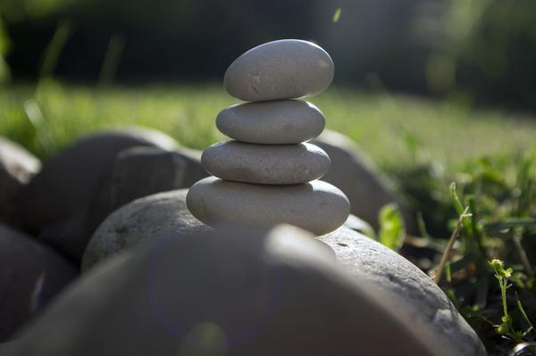 Harmony and balance - zen sculpture of white pebbles in a single tower