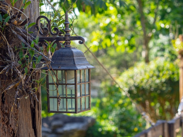 Classic style of lantern hanging on the fence in the garden