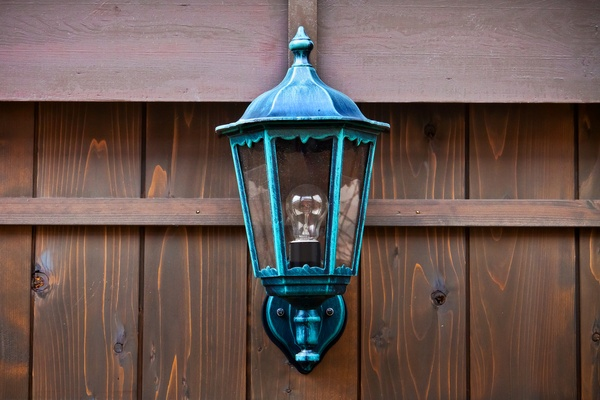 Lamp on a Wood Fence