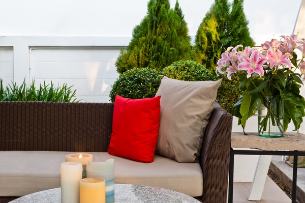 Outdoor patio seating area with candles