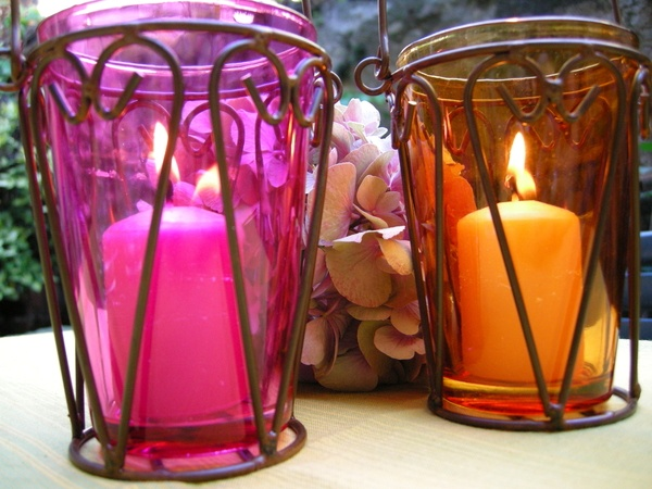 Ambiance candle lanterns lit in coloured glass lanterns