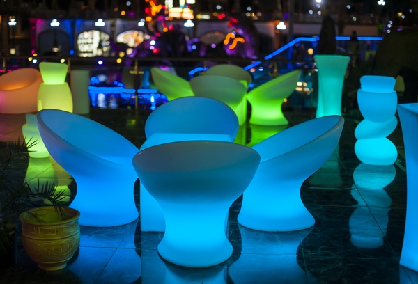 Modern garden furniture glowing at night