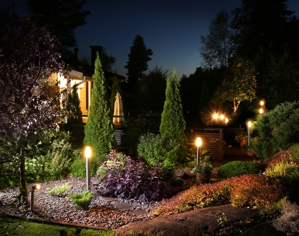 Garden with post lights at night