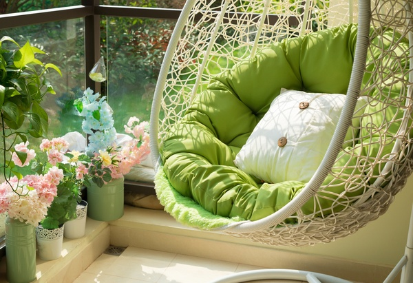 Garden swing with mattress and cushion in a balcony