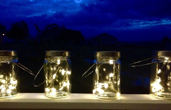Fairy lights inside retro vintage top jars with handles